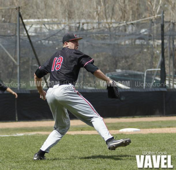 Pitcher Kevin Marnon (18) picks up the ground ball to throw the runner out at first base. Photo: Walter Cronk