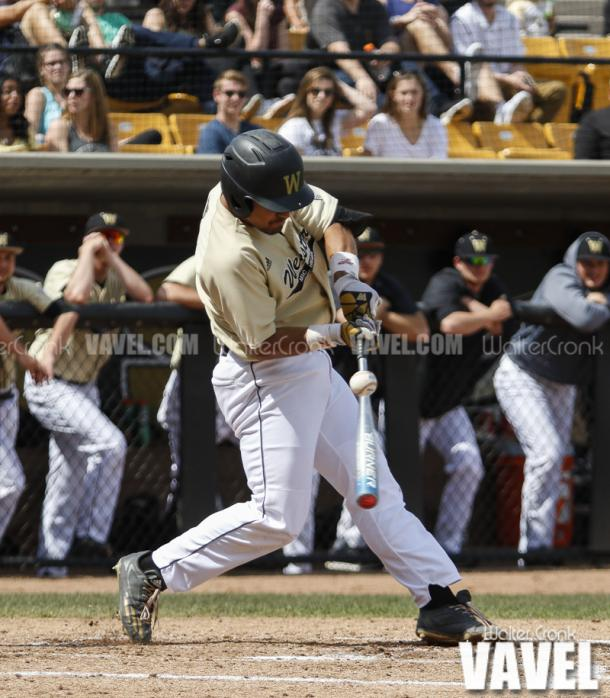 Grant Miller (1) hits one off the handle. Photo: Walter Cronk
