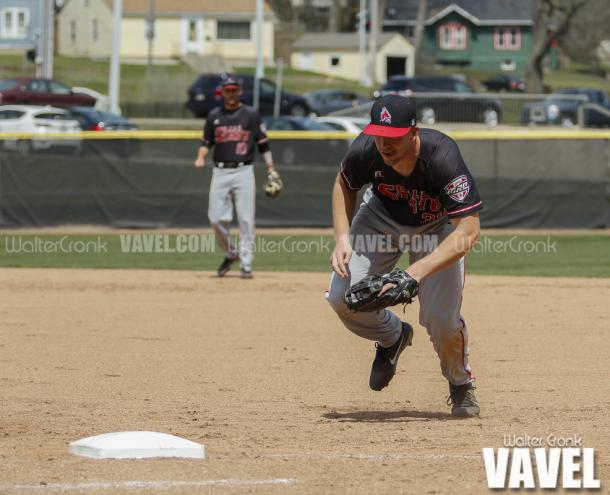 Caleb Stayton fields (34) fields the ball and rushes to first base to get the out. Photo: Walter Cronk