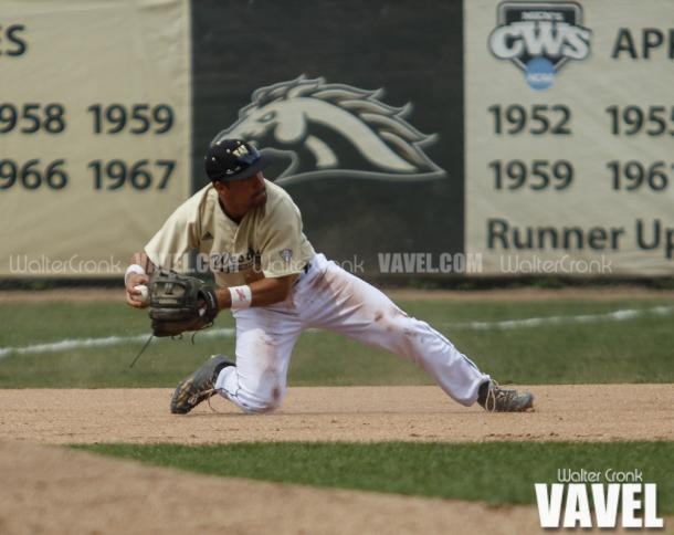 Grant Miller (1) makes the diving stop at third base to throw the runner out at second. Photo: Walter Cronk
