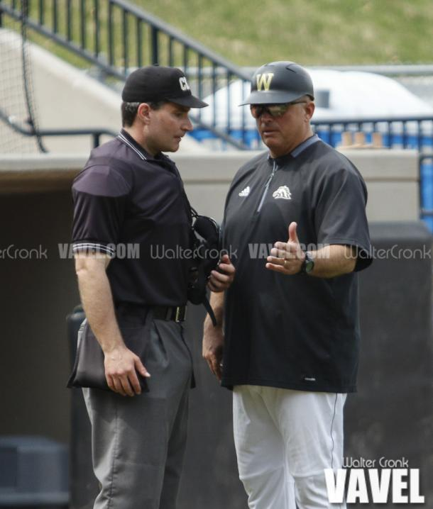 Western Coach Billy Gernon discussing a call with Umpire Darren Budahnn. Photo: Walter Cronk