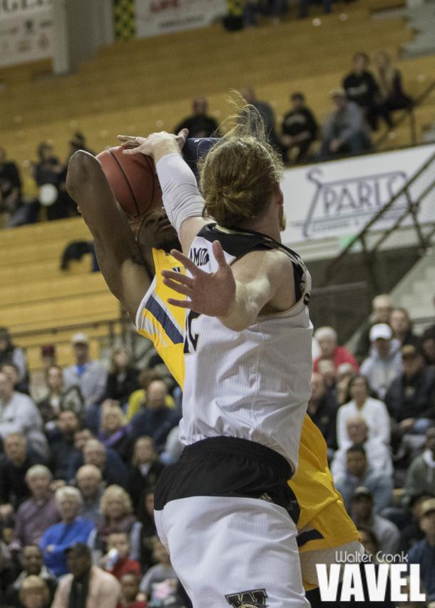 Drake LaMont (42) tries to block the shot. Photo: Walter Cronk