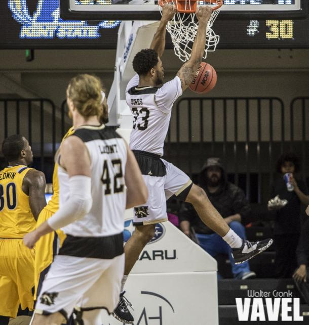 Reggie Jones (23) got the play of the game with the only dunk of the night. Photo: Walter Cronk