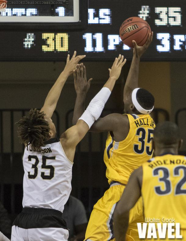 Jimmy Hall (35) of Kent State go's for the one handed shot against Brandon Johnson (35) of Western Michigan. Photo: Walter Cronk