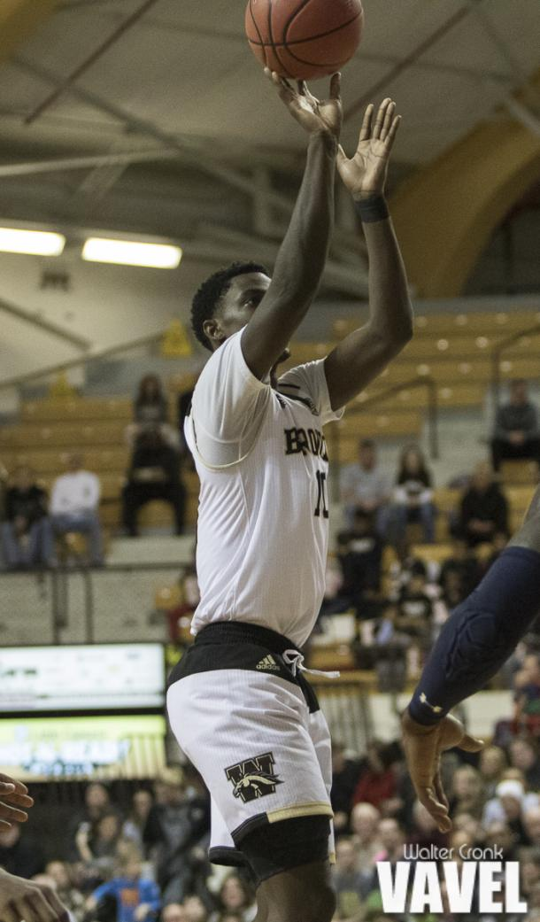 Thomas Wilder (10) shoots the uncontested jumper. Photo: Walter Cronk