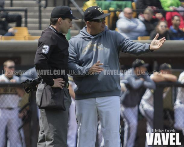 Head Coach Billy Gernon having a discussion with Umpire Stephen Linton about a call on the field. Photo: Walter Cronk