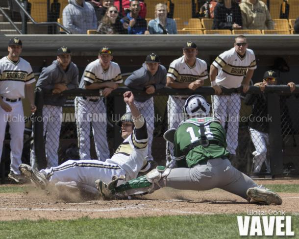 Tanner Allison (8) beats the throw to home plate. Photo: Walter Cronk