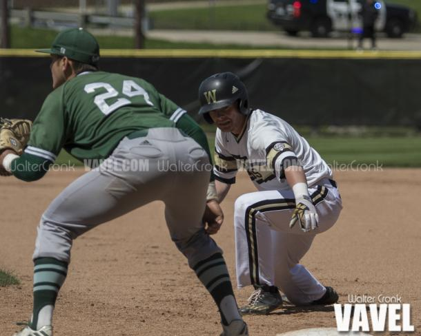 Connor Smith (2) starts his dive back to 1st base. Photo: Walter Cronk