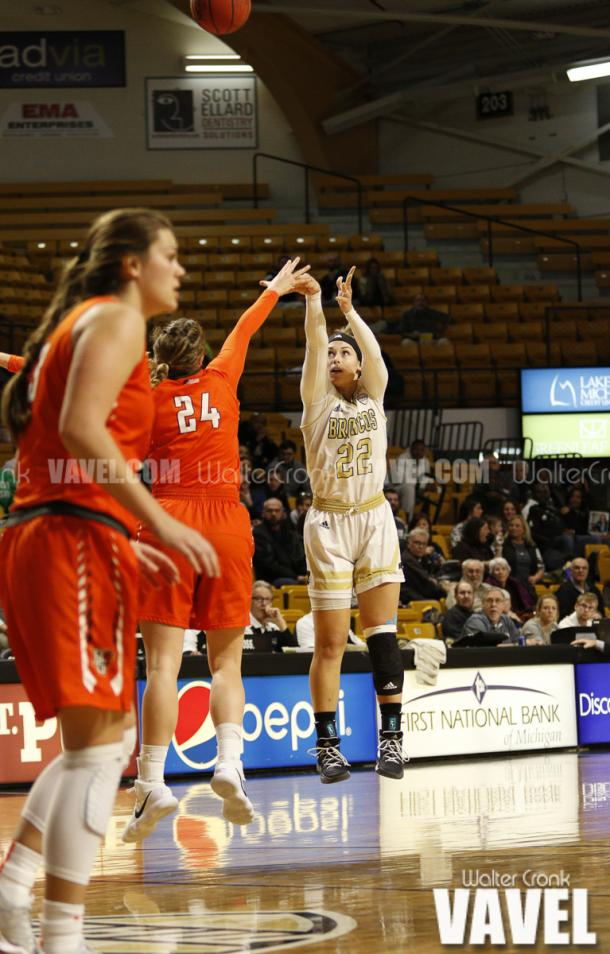 Meredith Miller (22) takes the shot with Jane Uecker (24) in her face. Photo: Walter Cronk