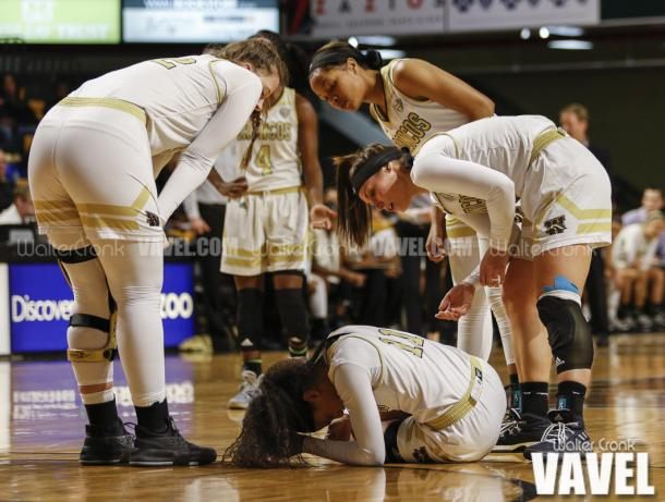 Teammates check on Kamrin Reed (11) after she go's down with an injury. Photo: Walter Cronk