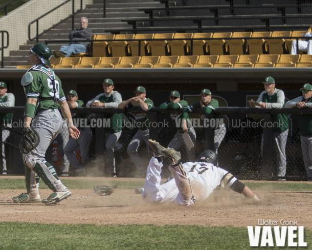 Tyler Frank (17) slides into home to win the game for Western Michigan. Photo: Walter Cronk