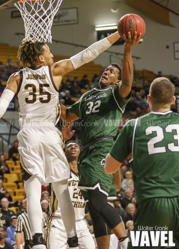 Brandon Johnson (35) tries to block the shot of Montana Byrd (32). Photo: Walter Cronk