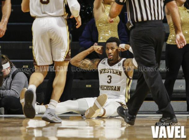 Josh Davis (3) flexes after scoring and getting fouled in the process. Photo: Walter Cronk