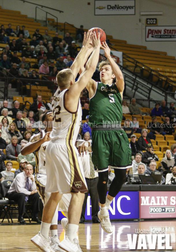 Alex Dubovitskiy (5) tries to get the shot off above TJ Clifford (32). Photo: Walter Cronk