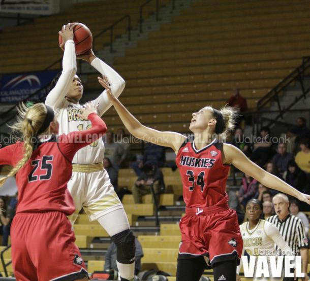 Breanna Mobley (10) takes the jump shot over Ally May (34). Photo: Walter Cronk