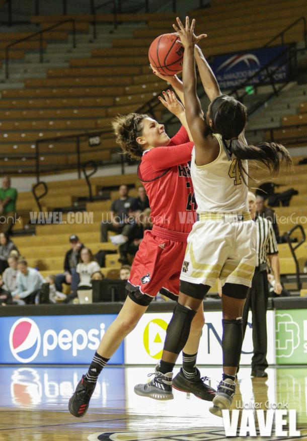 Deja Wimby (4) blocks the shot of Paulina Castro (24). Photo: Walter Cronk