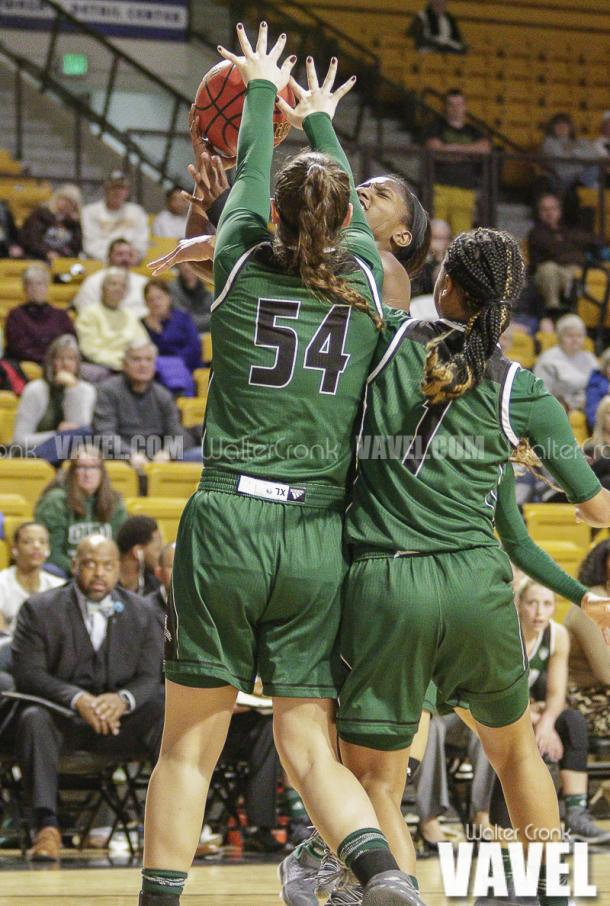 Deja Wimby (4) runs into Kendall Jessing (54) and Cierra Hooks (1) trying to get to the hoop. Photo: Walter Cronk