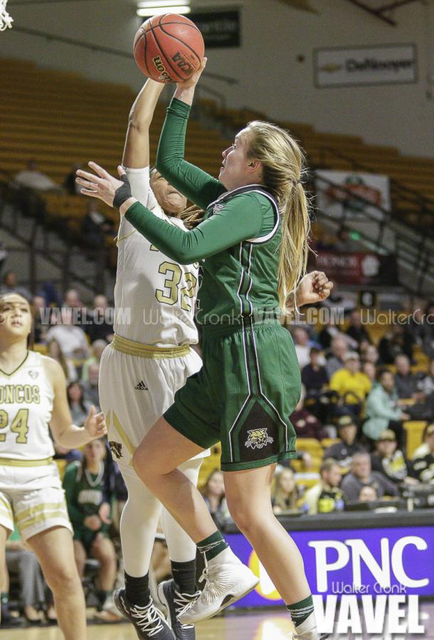 Katie Barker (2) gets the shot off before LaTondra Brooks (32) can get to her. Photo: Walter Cronk