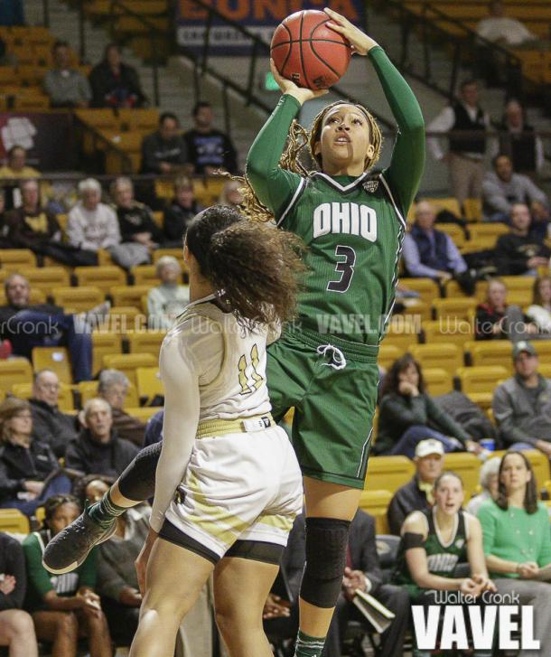 Amani Burke (3) gets the shot off above Kamrin Reed (11). Photo: Walter Cronk