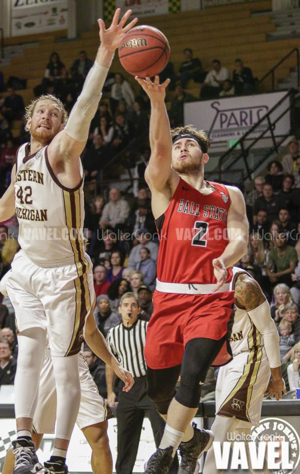 Tayler Persons (2) gets past Drake LaMont (42) for the lay up. Photo: Walter Cronk