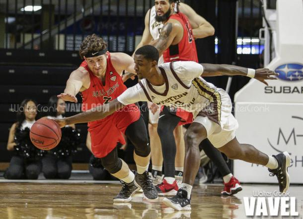 Thomas Wilder (10) and Tayler Persons (2) race for the loose ball. Photo: Walter Cronk
