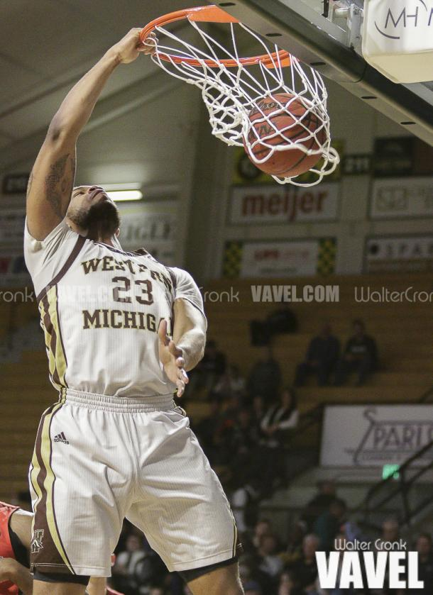 Reggie Jones (23) gets two points with the dunk. Photo: Walter Cronk