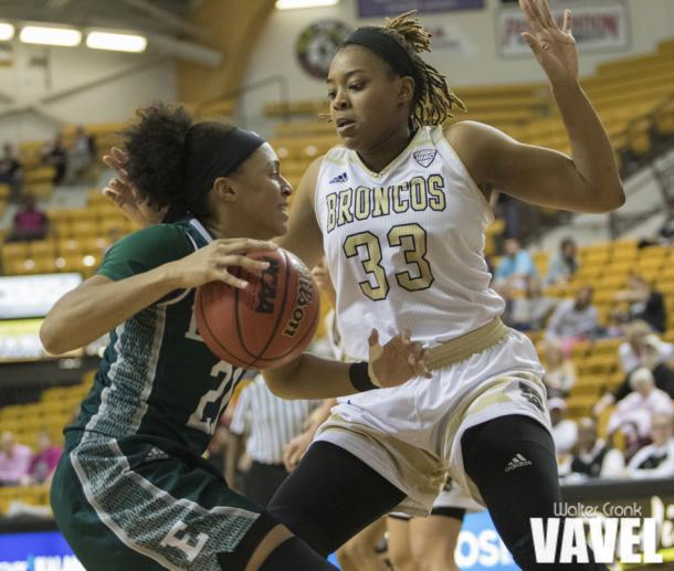 Marley Hill (33) not letting Phillis Webb (21) get to the basket. Photo: Walter Cronk