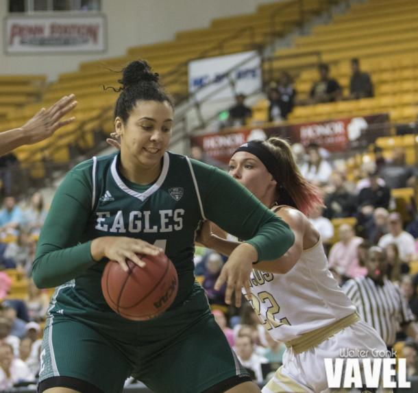 Ashley Nickens (44) tries to back down Meredith Miller (22) to get closer to the basket. Photo: Walter Cronk