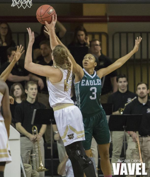 Emma VanZanten (52) go's for two points over Tori Easley (3). Photo: Walter Cronk