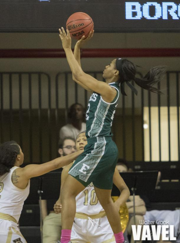 Sheyna Deans (22) go's up for two points late in the game. Photo: Walter Cronk