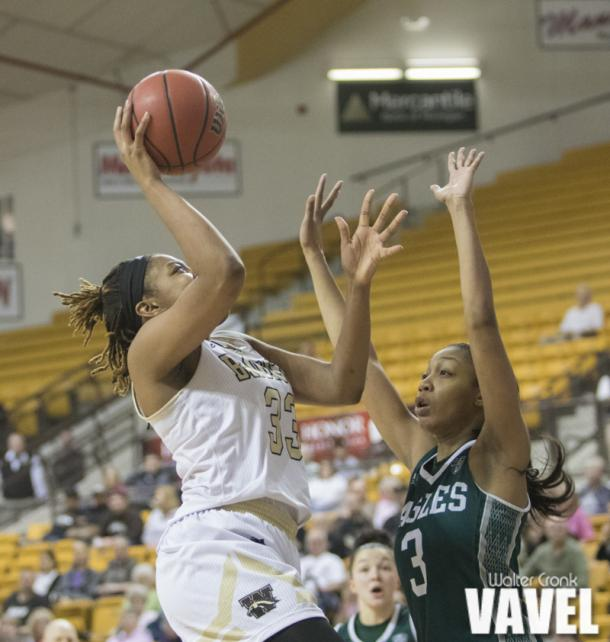 Marley Hill (33) takes the shot over Tori Easley (3). Photo: Walter Cronk