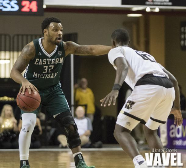 Eastern Michigan's Ty Toney (32) directs the offense from the top of the arc. Photo: Walter Cronk