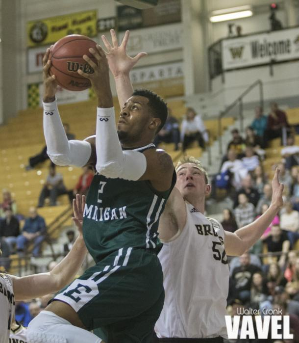James Thompson IV (2) go's for the lay up under the basket. Photo: Walter Cronk