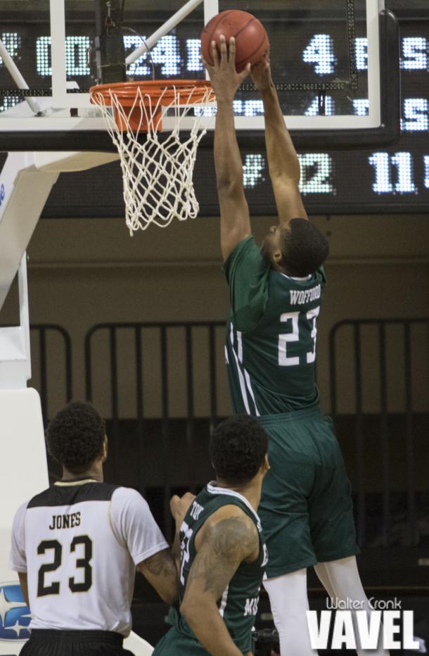 Lamar Wofford-Humphrey (23) gets the easy dunk. Photo: Walter Cronk