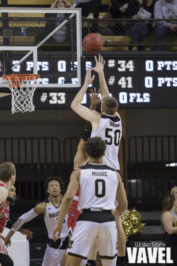 Seth Dugan (50) takes the jump shot over the Ball State defense. Photo: Walter Cronk