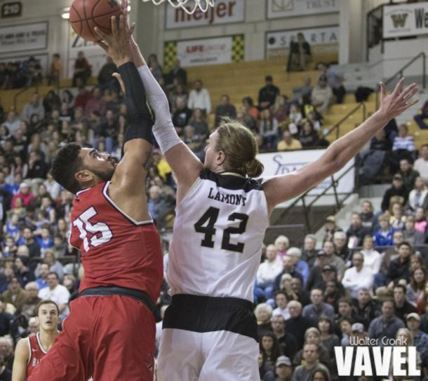 Drake LaMont (42) gets the block on Franko House (15). Photo: Walter Cronk