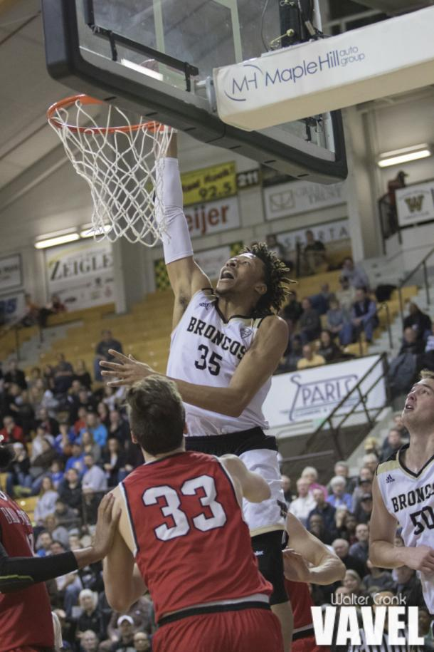 Brandon Johnson (35) scores off the one handed dunk. Photo: Walter Cronk