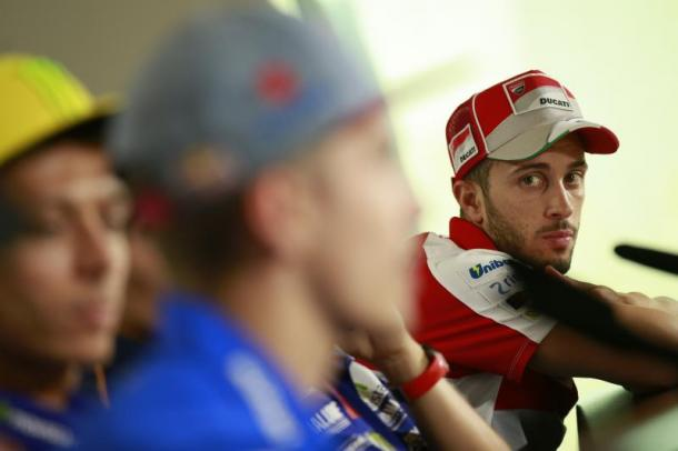 Dovizioso watches on as Vinales discusses his win - www.motogp.com