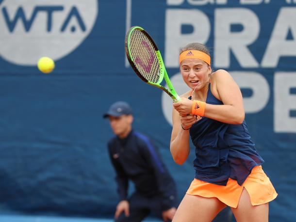 Jelena Ostapenko hits a backhand | Photo: J&T Banka Prague Open