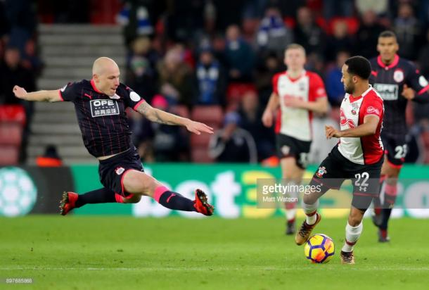 SOUTHAMPTON, ENGLAND - DECEMBER 23: Huddersfieldâs Aaron Mooy(L) launches into tackle on Nathan Redmond(R) during the Premier League match between Southampton and Huddersfield Town at St Mary's Stadium on December 23, 2017 in Southampton, England. (Photo by Matt Watson/Southampton FC via Getty Images)