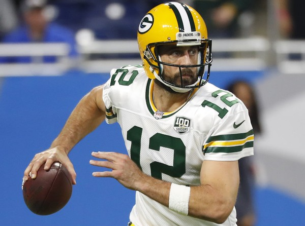 Aaron Rodgers has criticized some of McCarthy's decisions this season   Source: Getty Images