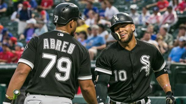 Chicago White Sox second baseman Yoan Moncada (10) is greeted by first baseman Jose Abreu (79) after hitting a first inning solo homerun against the Texas Rangers. |Ray Carlin-USA TODAY Sports|