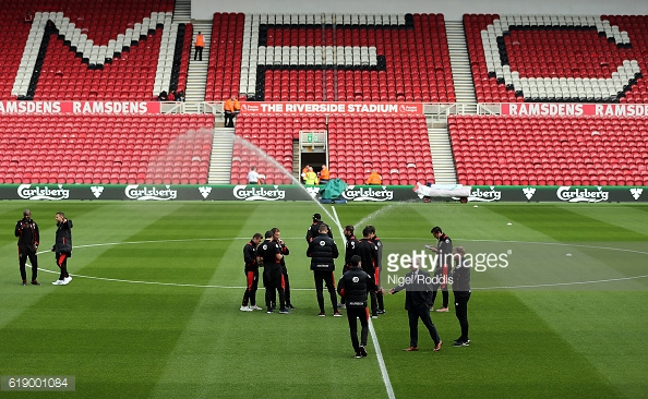Bournemouth players inspecting the pitch ahead of kick off at the Riverside | Photo: GettyImages/Nigel Roddis