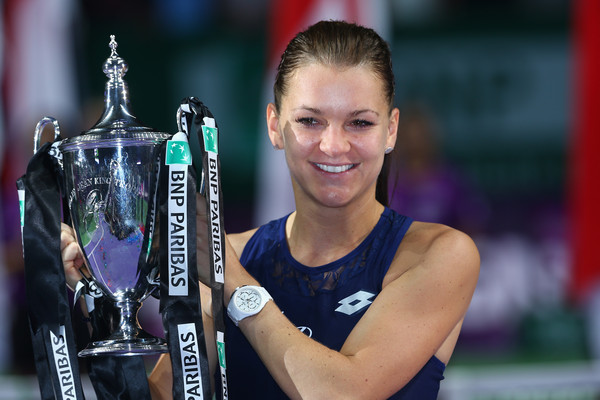 Radwanska holding the Billie Jean Trophy following her victory over 2011 champion Petra Kvitova in last year's final (Photo by Clive Brunskill / Getty Images)
