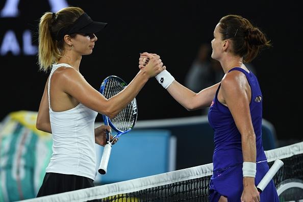 Radwanska and Pironkova shake hands at the net (Photo by Greg Wood / Getty Images)