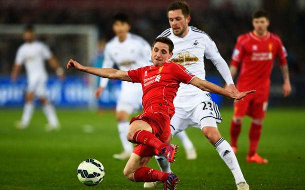 Whilst Leicester and Southampton are interested, Allen's former club Swansea have lodged a bid (photo: Reuters)