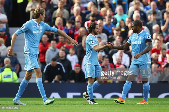 Joe Allen celebrates scoring his sides first goal with his team mate Glen Johnson during the Premier League match between Manchester United and Stoke City at Old Trafford. | Photo: Clive Brunskill/Getty Images