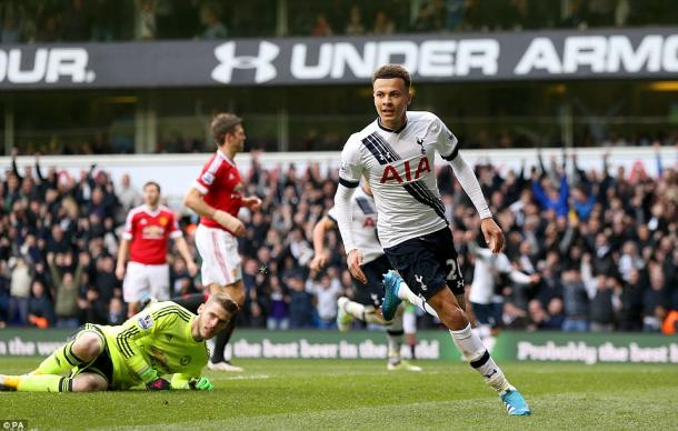 Alli wheels away after giving Spurs the lead (photo: PA)
