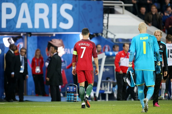 Ronaldo and Almer exit the field after a night of contrasting fortunes | Photo: VI Images/Getty Images