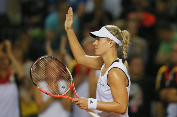 Angelique Kerber celebrates after her victory over Romania in Fed Cup/Getty Images